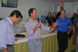 Mike Weir welcomed family friends to his new retail shop in Beamsville; Mike Weir Winery's first such shop despite opening for business in 2005. Winery president Barry Katzman, left, and Lincoln Mayor Bill Hodgson listen attentively.  Williscraft - Photo