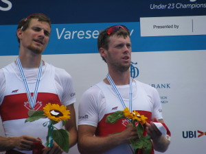 Grayson Gray of Thorold, left, and James Myers of Beamsville on the podium in Italy as they received their bronze medals at the U23 World Rowing Championship in July.