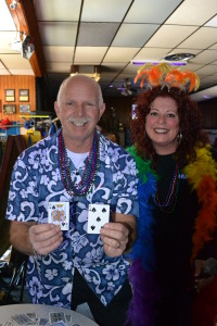 Bowling a strike or spare earned team members playing cards: best poker hand earned a prize. Grimsby alderman Dave Kadwell celebrates the first strike of the morning. With him is Renee Rebelo, Grimsby DIA chair