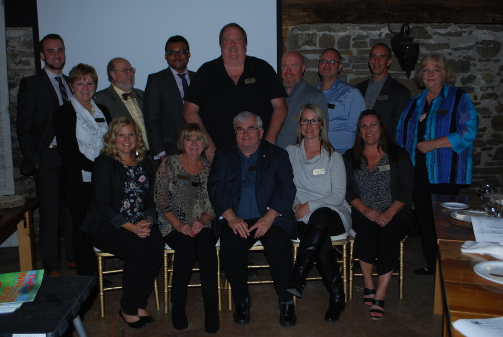 Standing (L to R) Brian Teichgraf, chamber manager Cathy McNiven, David Hoare, Siva Sivapalan, Mike Williscraft, Gary Bruce, Marty Vorstenbosch, David Csordas, and membership coordinator Denise Potter. Front: Laura Petrunick, Lisa Pare, Rob Foster, Tineke Leech and Tess Stafford. Absent is Dianne Rintjema. Bratton - Photo