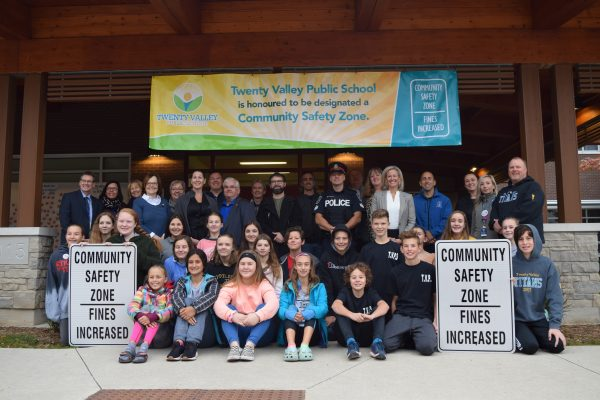 Governmental delegates pose with students from Twenty Valley PS