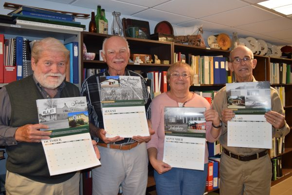 Friends of Lincoln's History holding onto their calendar.