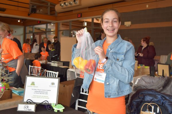 Gabbie Bilodeau and one of her eco-friendly grocery bags.