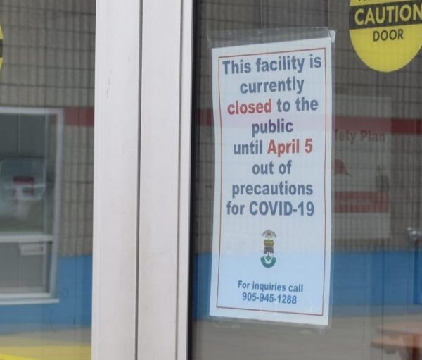 A sign posted to the door to the Peach King Arena describes the facility's closure.