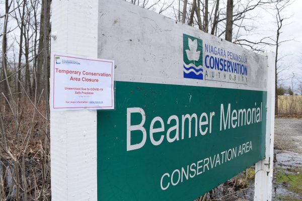A sign posted at Beamer emeorial park explains that the area has been closed due to coronavirus precautions.