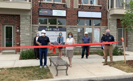 Several members of council and developer Gabe DeSantis cut a ceremonial ribbon.